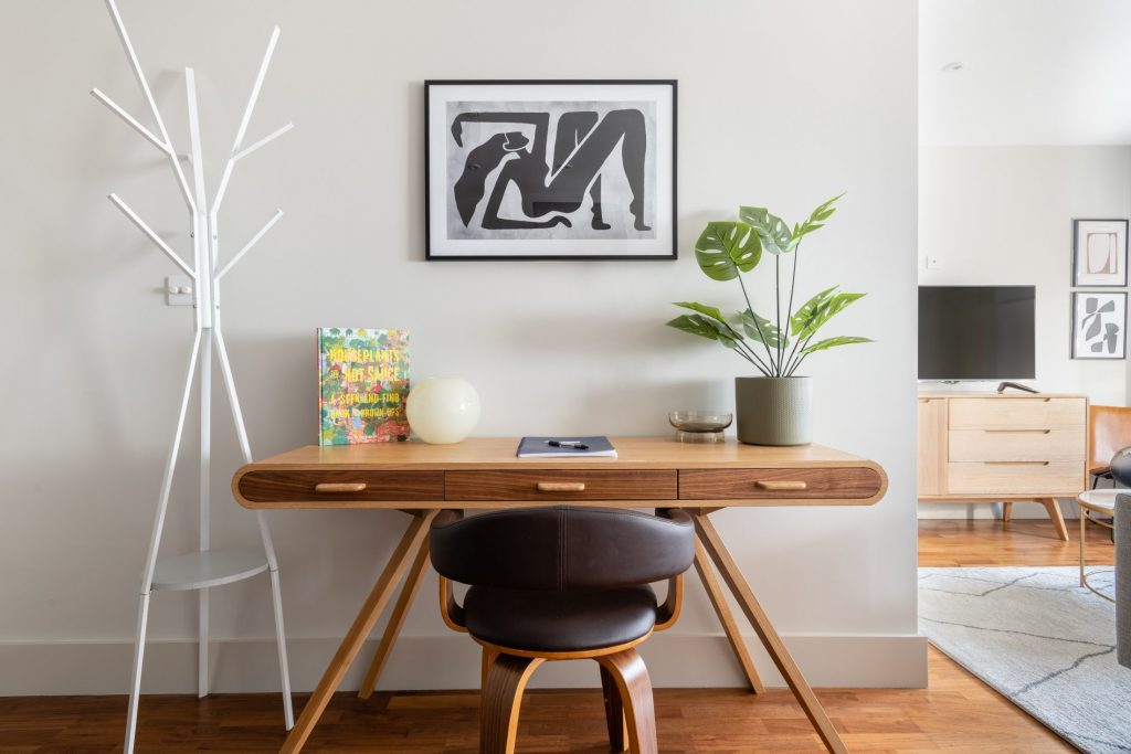 The Kennington Escape, work desk, house plant, coat stand and leather chair