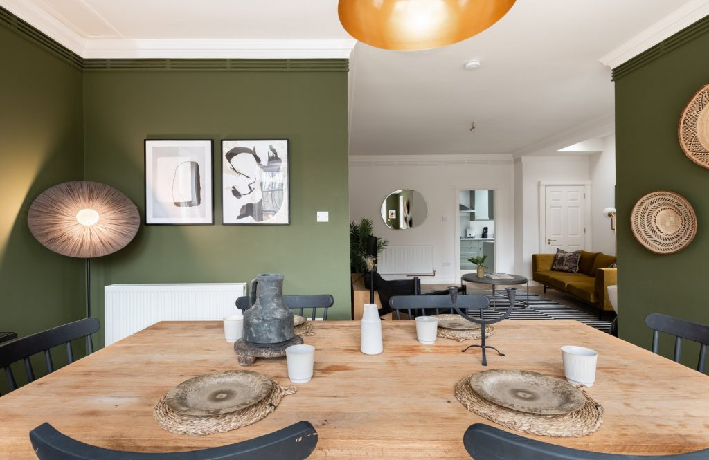 The Pimlico Townhouse, Dining room, walk through to living room and kitchen, olive green walls, mustard sofa