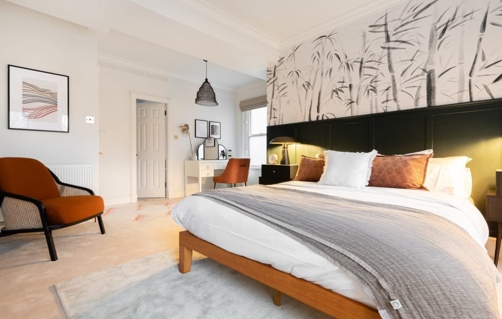 Large Bedroom, armchair, throw and scatter cushions, bright large bedroom