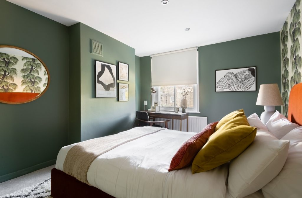 Large double bedroom, window, bright bedroom, scatter cushions and paintings