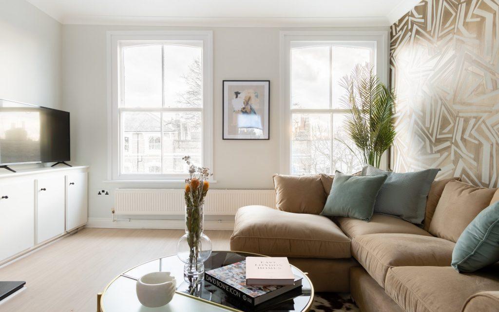 L shaped sofa, flat screen TV, Coffee table and books