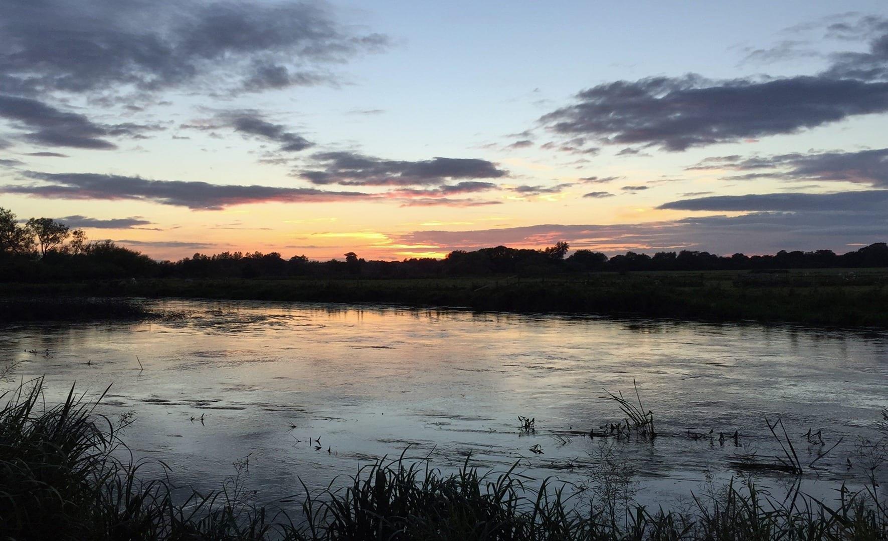 Riverside Lodge, across river sunset